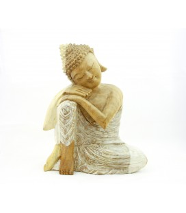 Pale hand on knee Buddha figurine